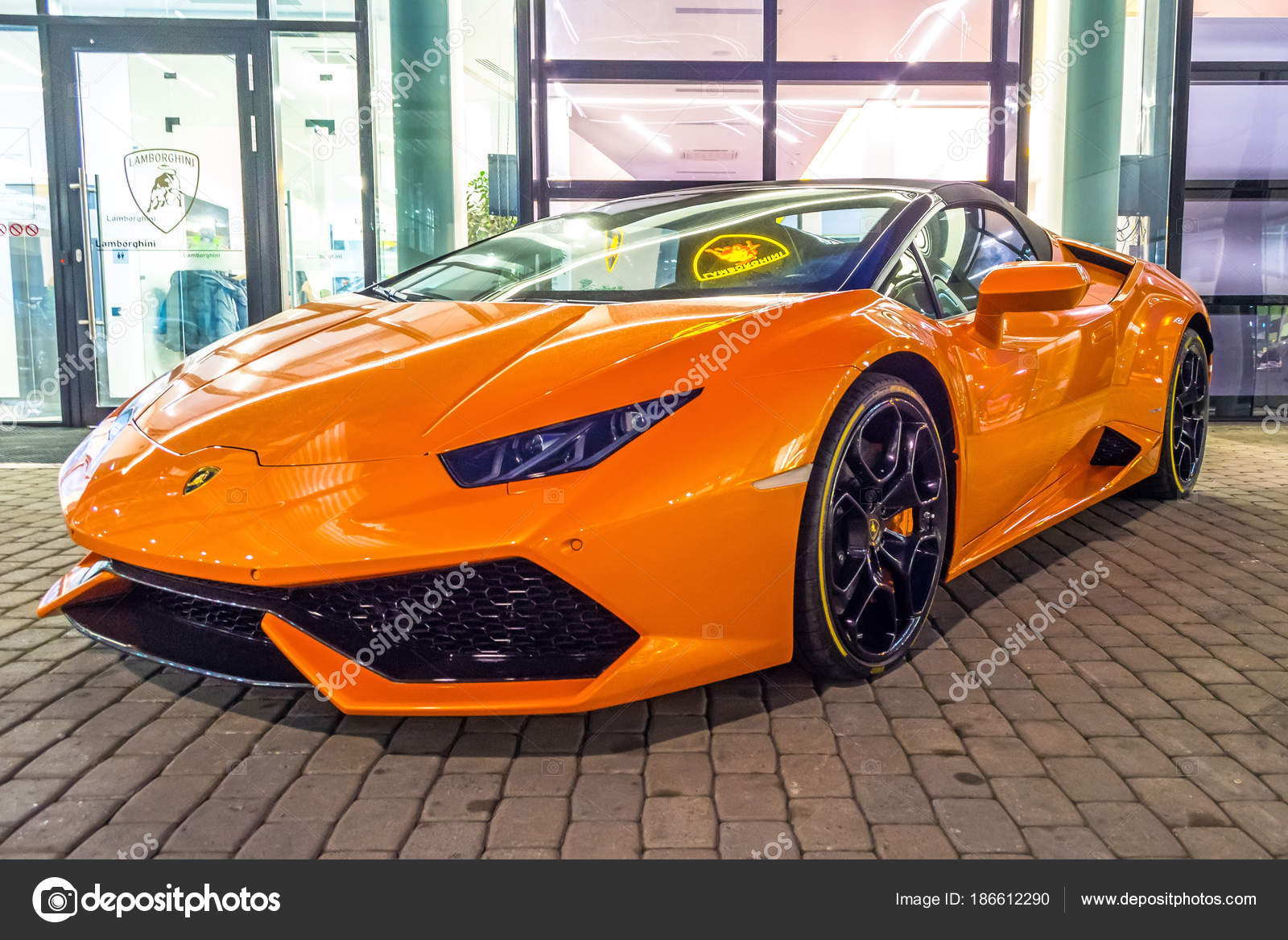 Supercar Lamborghini Huracan Orange Color Parked At The Car