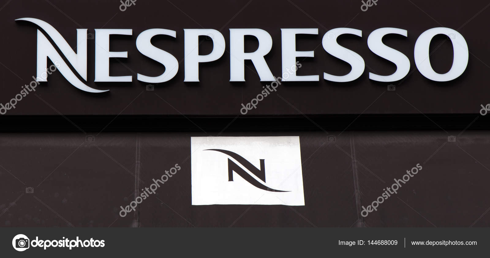 nespresso on a wall in amsterdam stock editorial photo