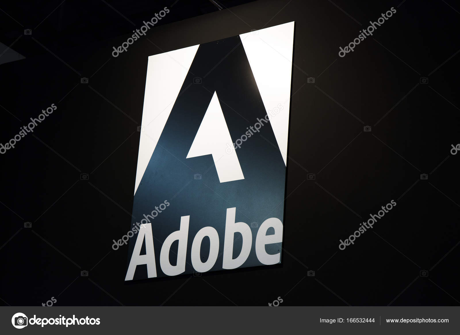 adobe logo and letters on a black wall stock editorial photo