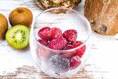 Fotografie Ripe raspberries in glass