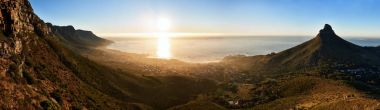 Panoramic landscape of sunset ocean and mountains in cape town
