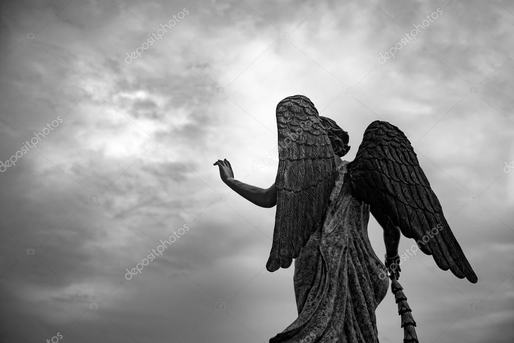 Waiting for some one, Angel statue hold her hand  to the sky.