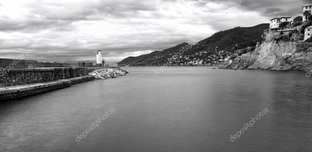 Camogli, the harbour entrance, wintertime. Black and white photo