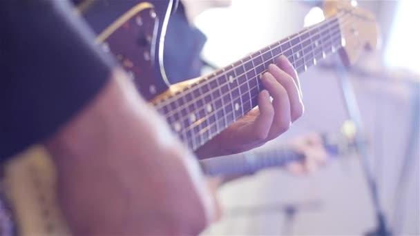 Playing guitar close-up slow motion macro. Guitarist hands pressing ...