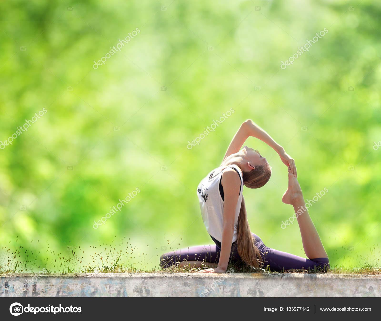 Teenage Girl Doing Yoga Outdoors Stock Photo