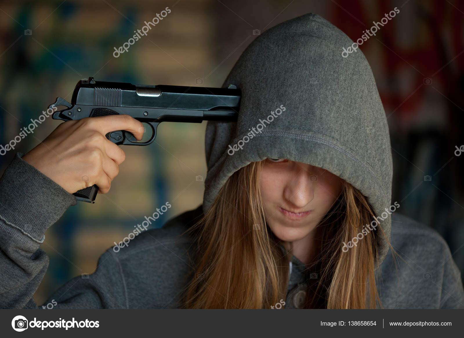 teen-girl-with-gun