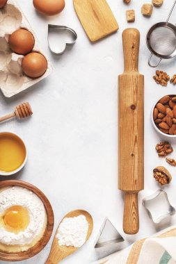 Ingredients for baking  - flour, wooden spoon, eggs.