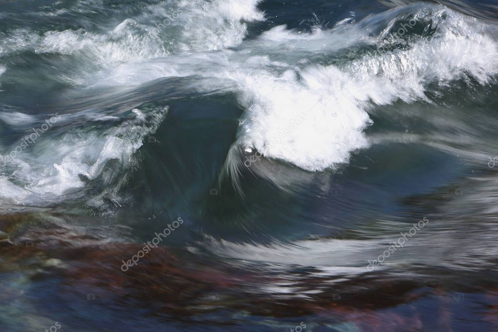 Crests of waves on the rifts of a river in the spring