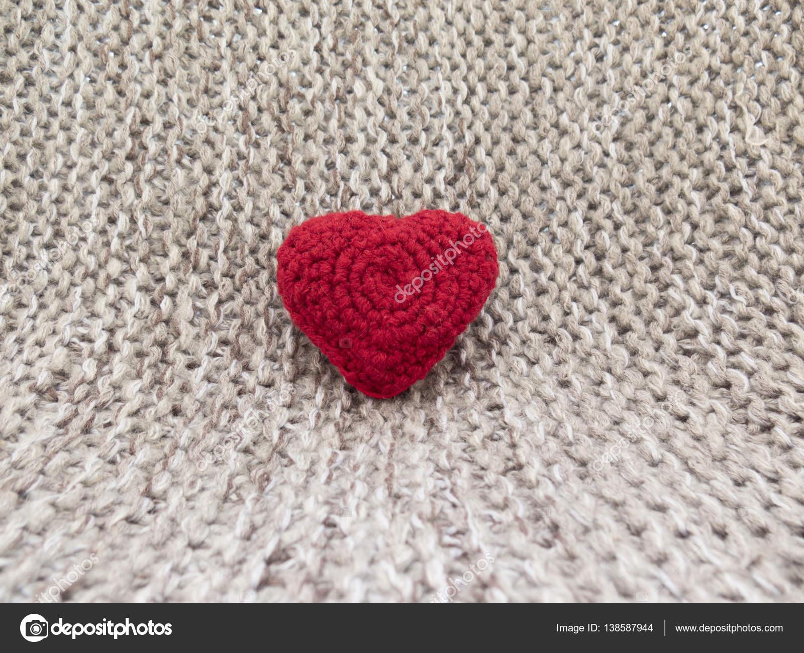 Die warmen Hintergrund des Tages aller Liebhaber mit Stricken Herzen ...