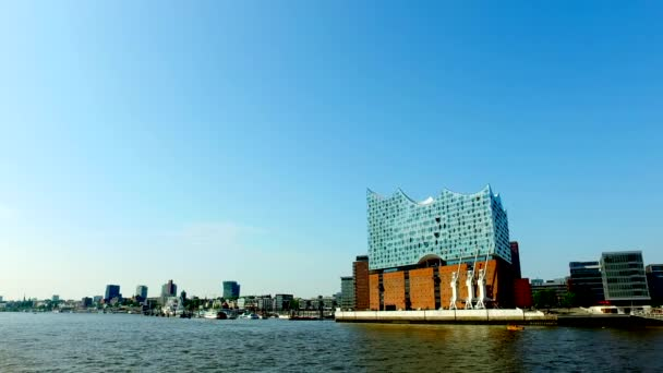 Hamburg Skyline - view from a boat passing by downtown, harbor and Hafen City with Elbphilharmony Concert Hall.