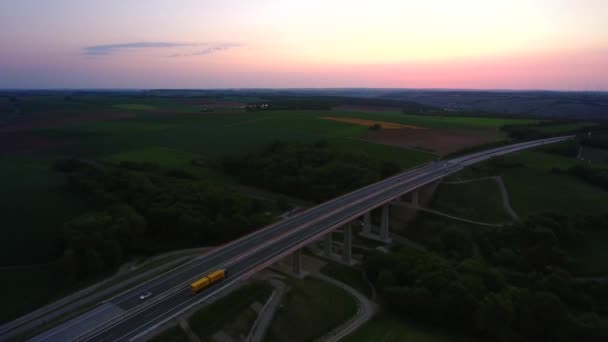 Aerial View of Traffic on a German Motorway during Sunset. Moderate traffic on the Highway A7 shortly before Wuerzburg.