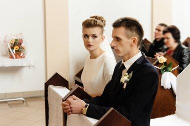 bride and groom preparing for communion