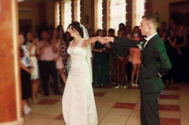 Romantic newlywed couple dancing