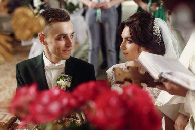 Emotional couple at wedding ceremony