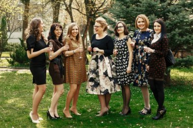 Women celebrating and toasting