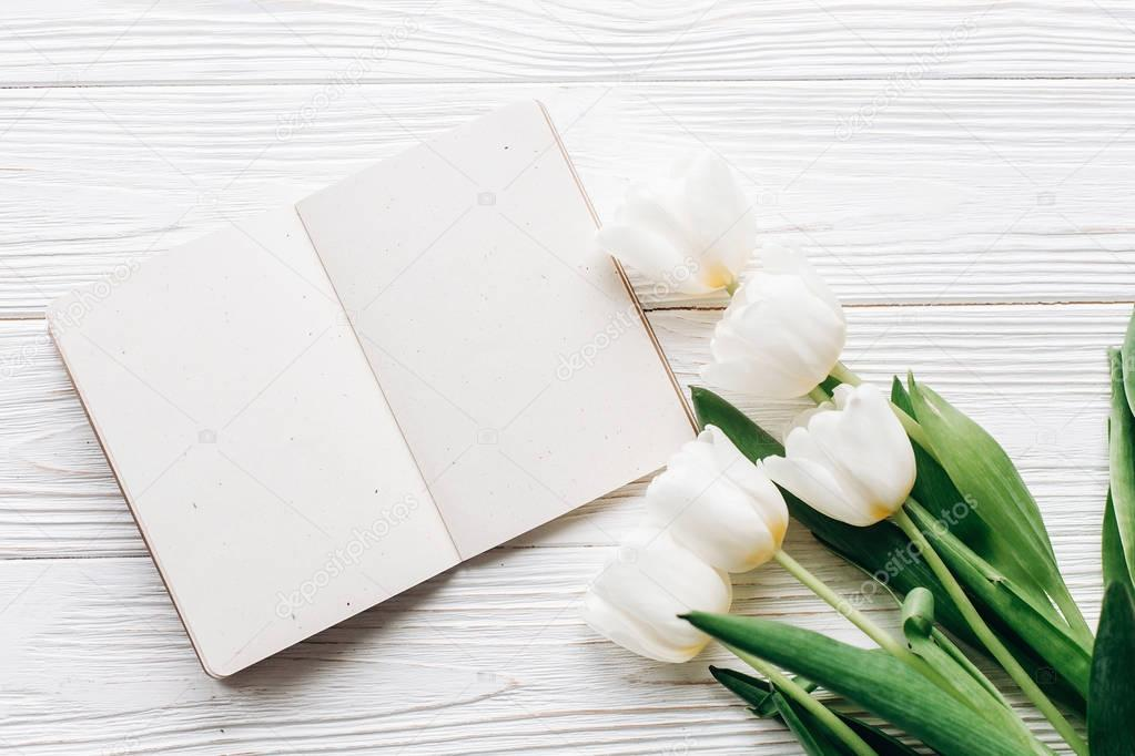 craft notebook, pen and white tulips