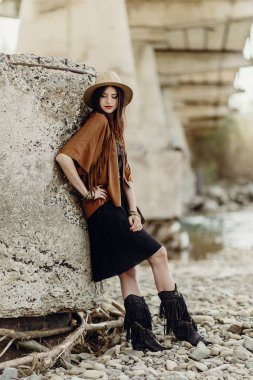 girl in hat and fringe poncho