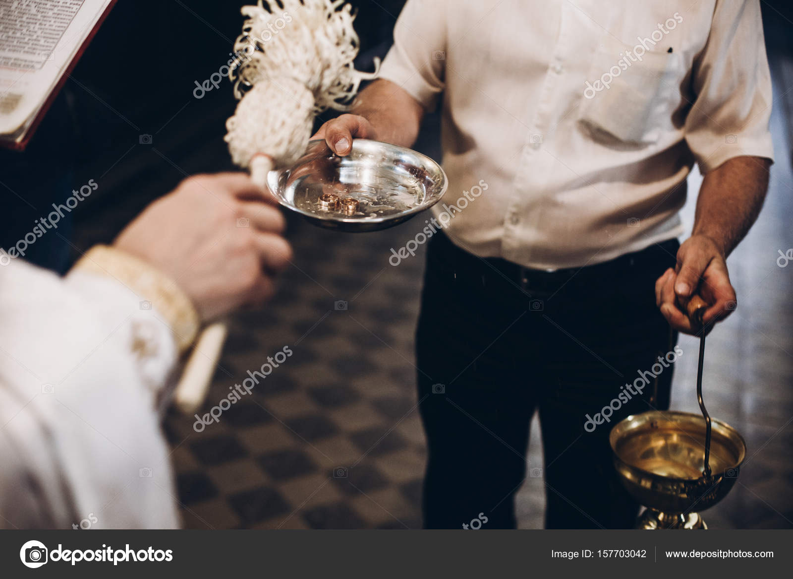 space priest holy text for blessing wedding photo with ceremony religion church rings water in