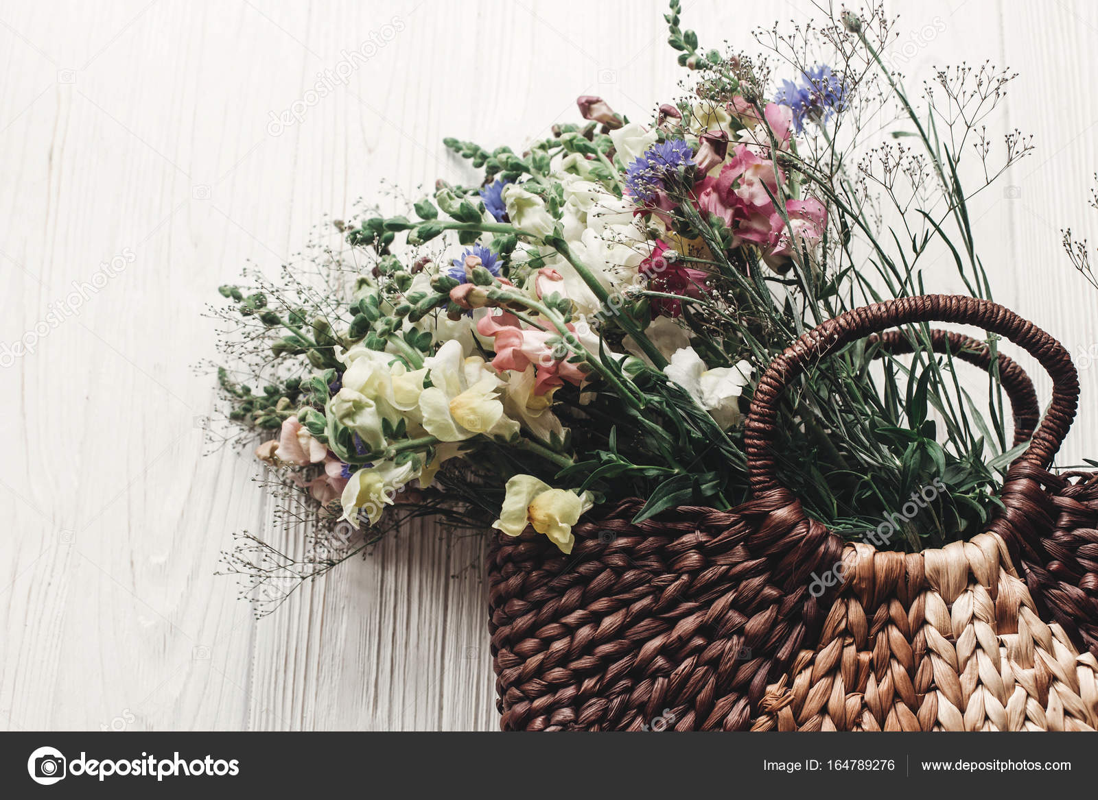 Flowers In Rustic Basket Stock Photo