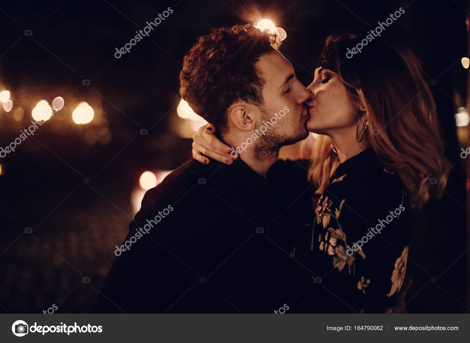 Couple hugging and kissing in night street in paris photo by