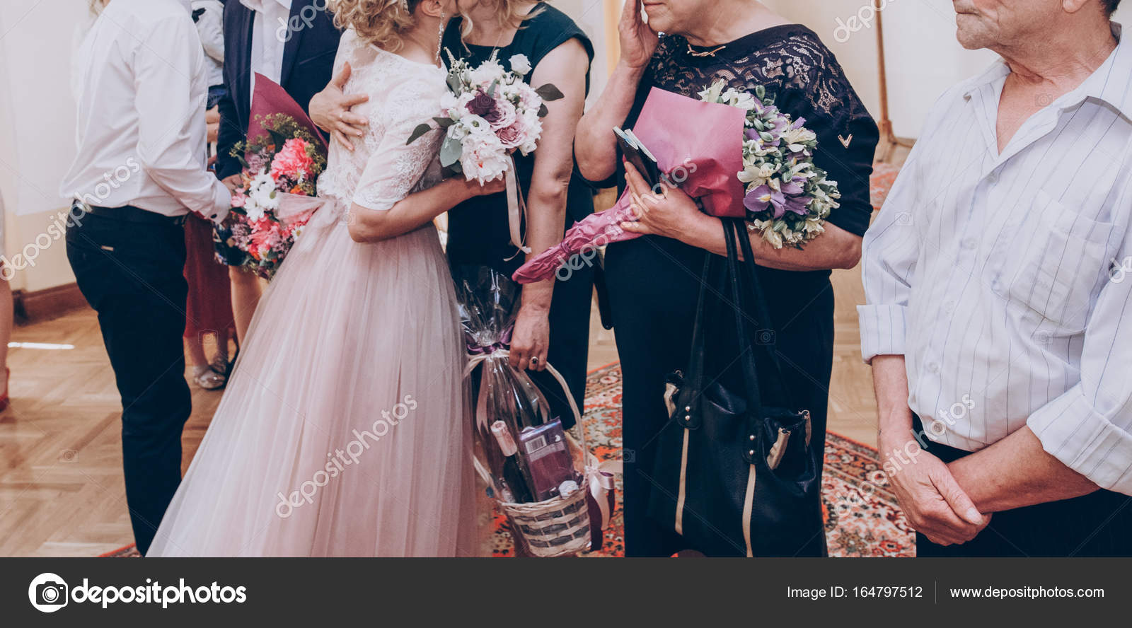 guests congratulating bride and groom stock photo