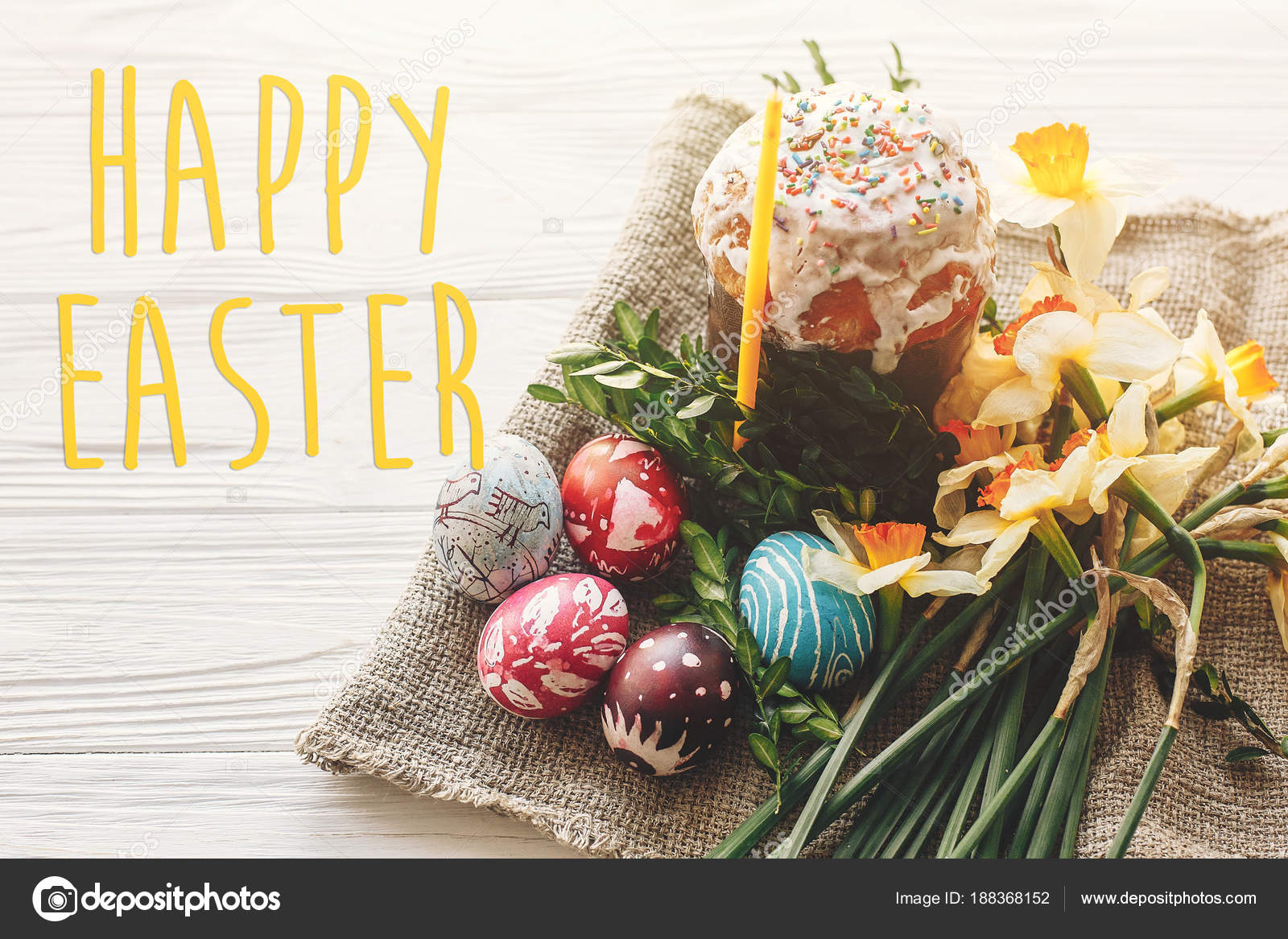 Happy Easter Text Seasons Greetings Card Stylish Painted Eggs And Cake On White Rustic Wooden Background With Spring Flowers Candle Modern
