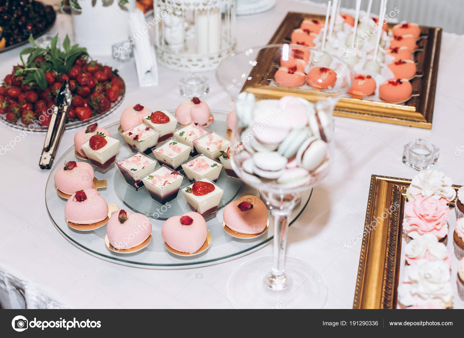 Delicious Sweets Cupcakes Roses Pops Candy Table Wedding Reception