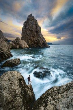 Man on a cliffs edge above the sea