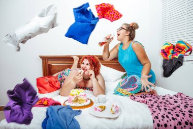 plus size women eating sweet pastry