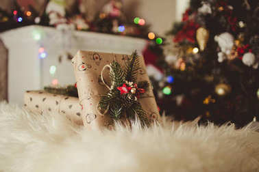 beautiful holiday gifts under the Christmas tree
