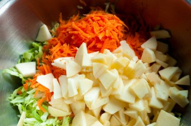 fresh salad of carrot and cabbage apples