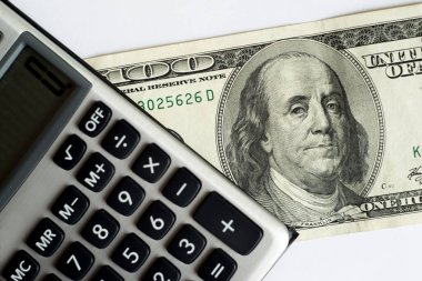 calculator on a white background, one hundred dollars usa