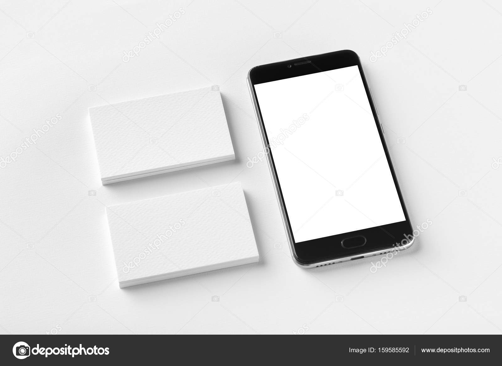 Mockup of two horizontal business cards and black cell-phone wit ...