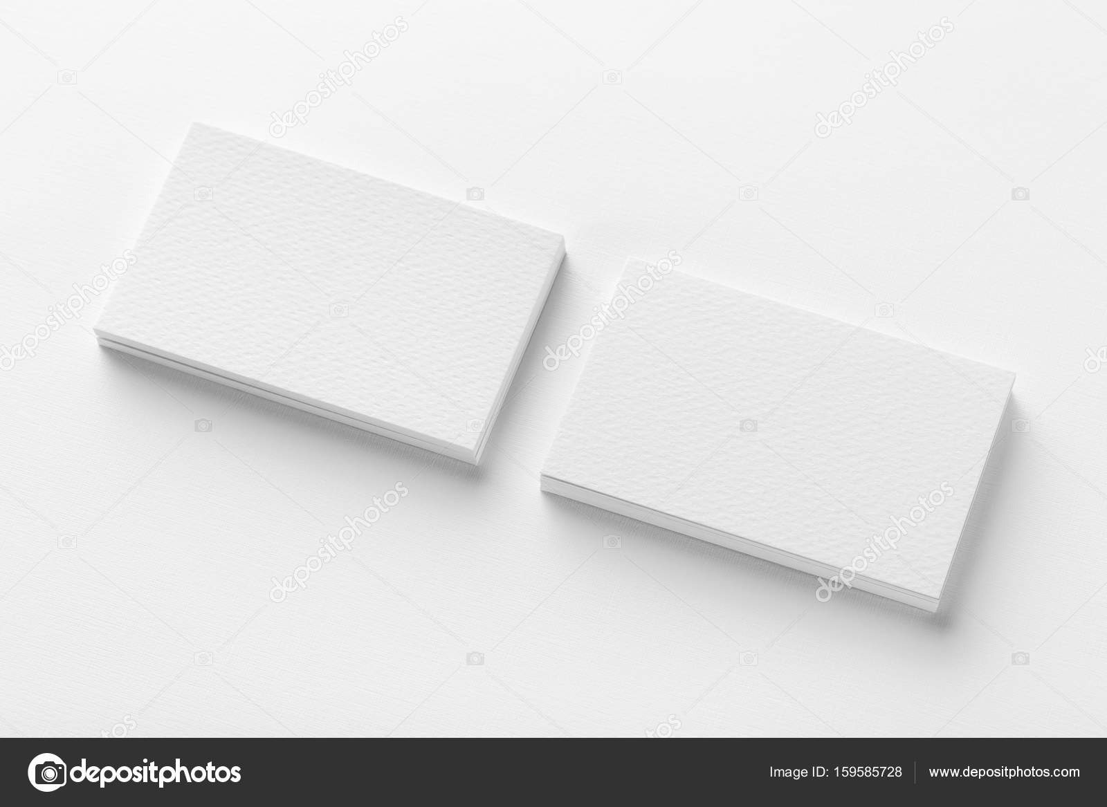 Mockup of two blank horizontal business cards stacks at white te mockup of two blank horizontal business cards stacks at white te stock photo colourmoves