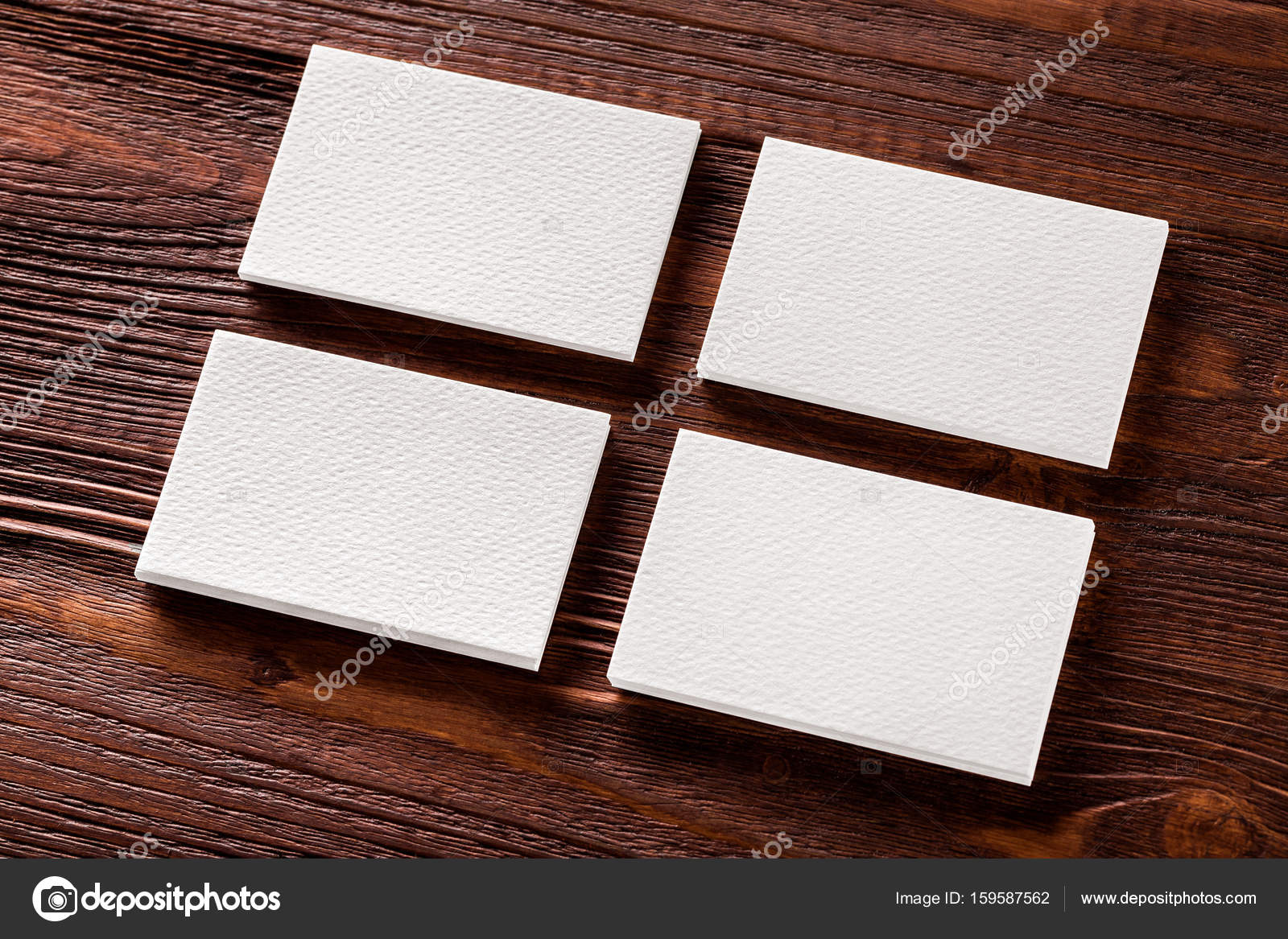 Closeup mockup of four blank vertical business cards at brown wo closeup mockup of four blank vertical business cards at brown wo fotografia de stock reheart Image collections