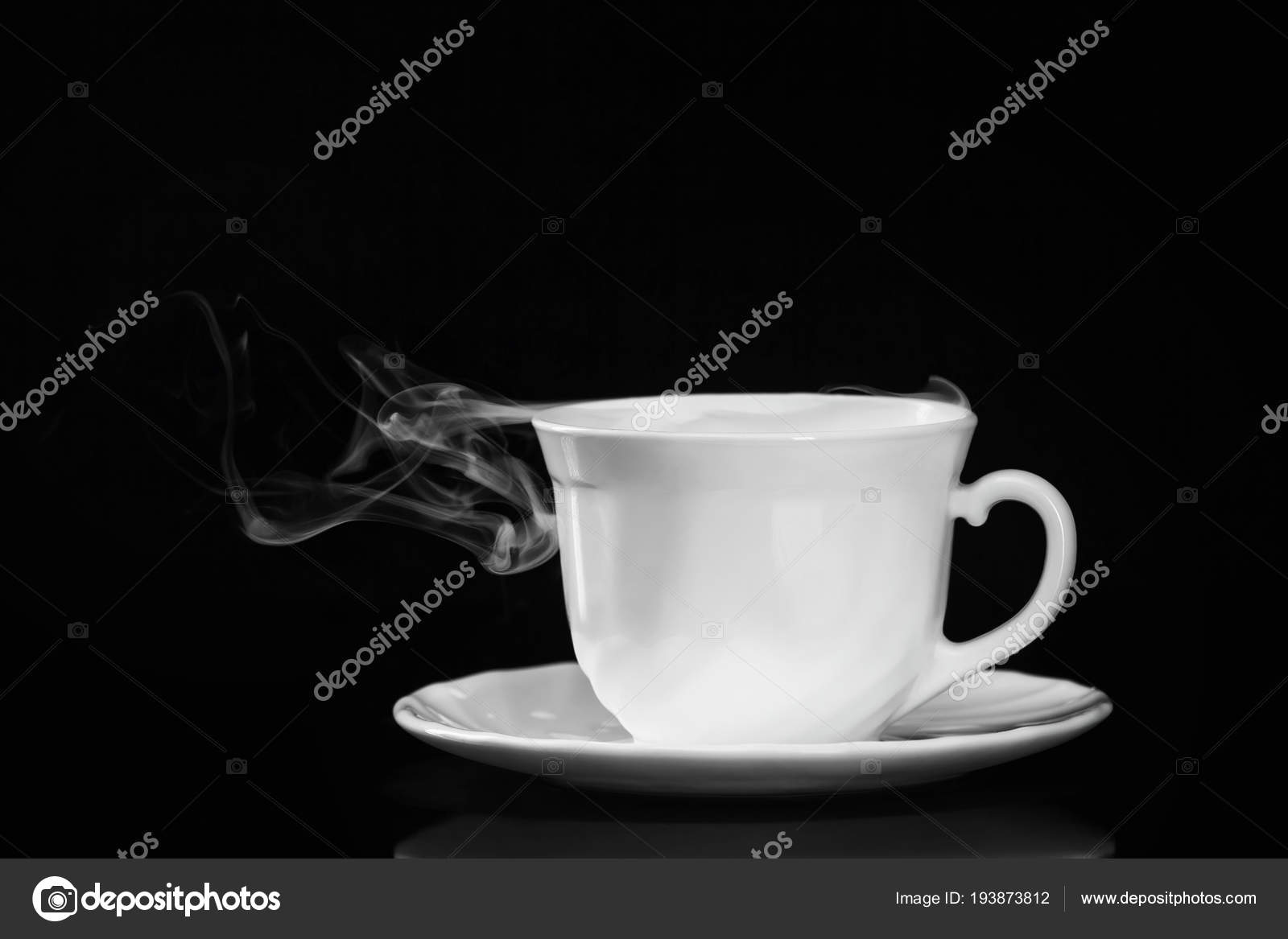 white cup tea saucer smoke isolated black background stock photo