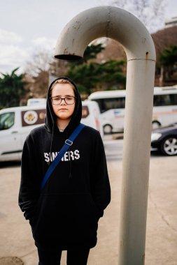 """Картина, постер, плакат, фотообои """"teenager in black clothes stand under fire hydrant"""", артикул 345160380"""