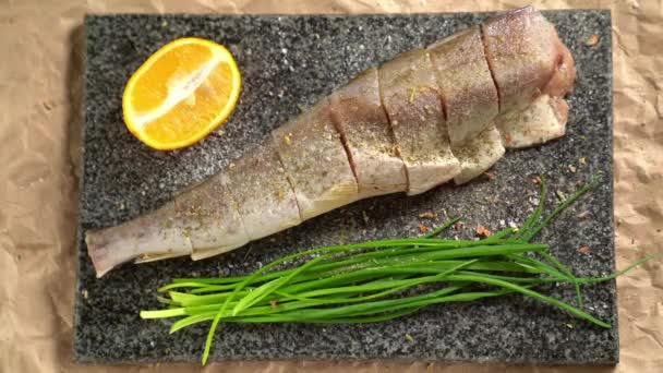 Cooking. Fish, onions  Board. sprinkle with pepper