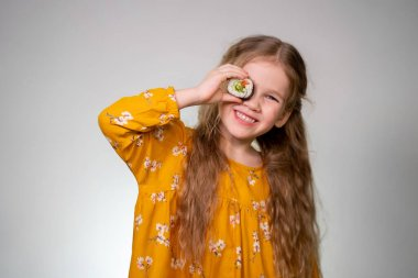 The Girl holding rolls have face like binoculars.