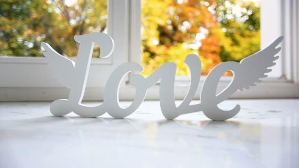 letters love on window