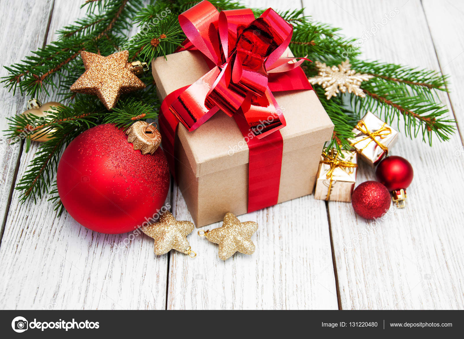 christmas gift box and decorations on a old wooden background photo by almaje