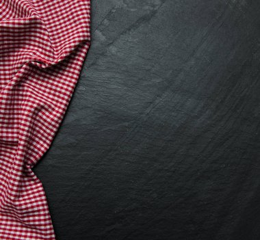 Checkered napkin on a black background