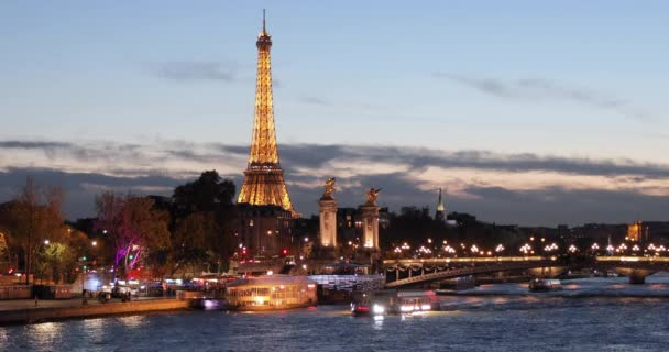 Paris, Tour boats on the Seine River at night with Eiffel tower in background