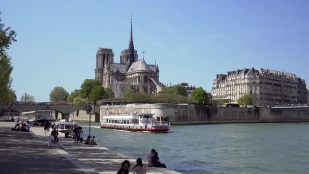Seine river and Cruise ship in Paris with Notre Dame cathedral in background