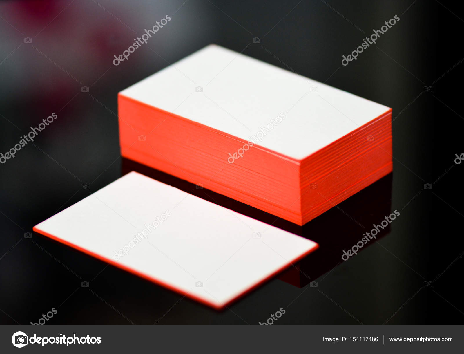 thick white cotton paper business card mock up with red painted ...