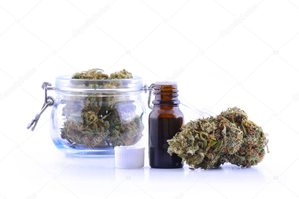Medicinal marijuana cannabis with extract oil in a bottle. cannabis CBD oil hemp products. Cannabis oil extracts in jar