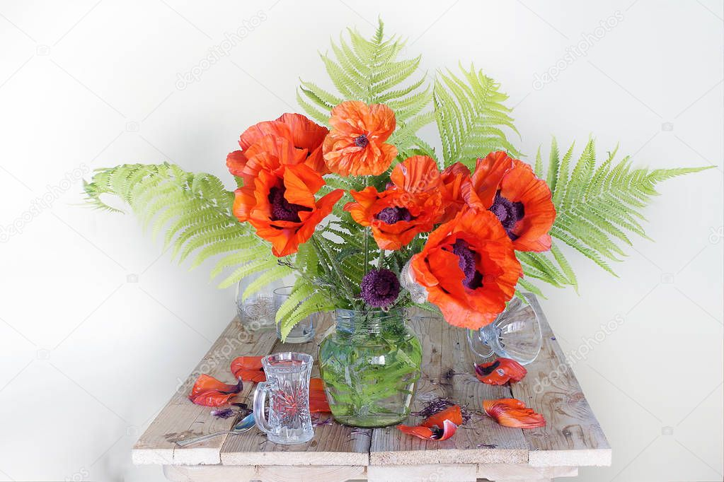 Still life with red poppies and wildflowers