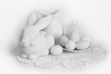 Easter still Life with eggs and a Bunny on a white background.