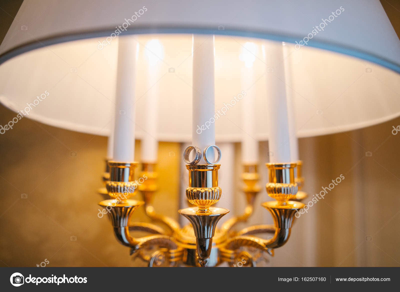 The Wedding Ring Of The Bride And Groom Lie On The Lamp In The Room U2014 Photo  By Prostooleh