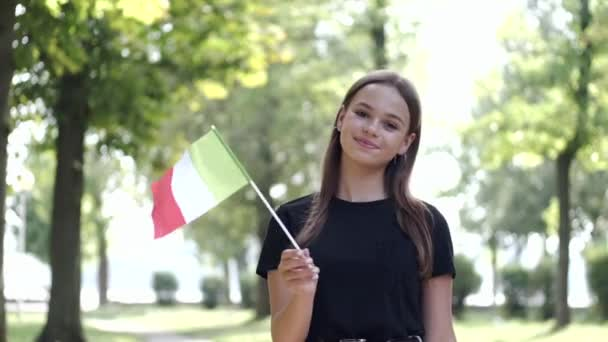 A student is waving the national flag of Italy